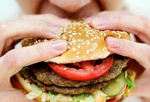 20100722-woman-eating-hamburger-300x205